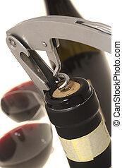 Corkscrew opening wine bottle