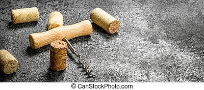 Corkscrew with wine corks.