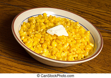 Bowl of corn with melted butter
