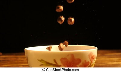 corn breakfast cereals falling in a bowl, slow motion