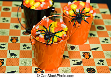 Corn Candy Creepers - Black spiders on corn candy in pails.