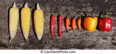 corn chili paprika wood table