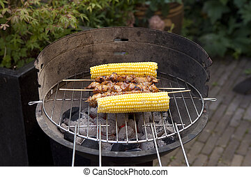 Corn cobs and grilled satay