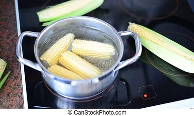 corn cooked in a pot on stove. timelapse