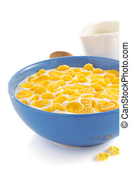 corn flakes and milk in bowl on white