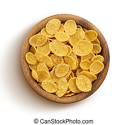 Corn flakes in wooden bowl isolated on white background, top view