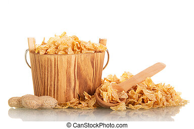 Corn flakes in wooden bucket and scoop isolated on white.