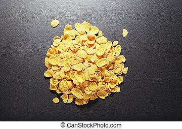 Corn flakes on a black background