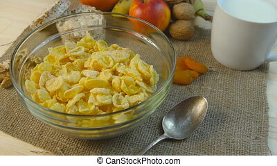 Corn-flakes rotating on table on morning