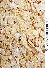 Corn flakes texture closeup pattern as background. Breakfast food photo.