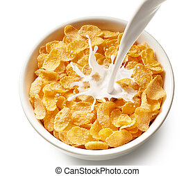 corn flakes with milk - pouring milk into bowl of corn...