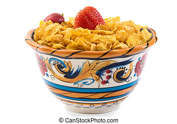 Bowl of corn flakes with strawberries. isolated on white. Part of the breakfast series images.