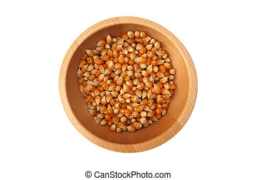 Corn grains in the wooden bowl
