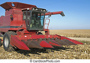 Corn harvester in Iowa - Corn harvester in corn field in...