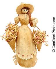 Corn husk doll isolated on white background