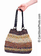 Corn husk straw bag separated on white background