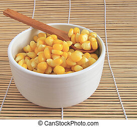 Corn in wooden spoons and bowls