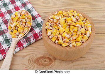 Corn on a plate on the table.
