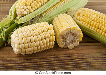 Corn on a wooden table close-up