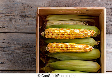 Corn on the cob in a wooden crate