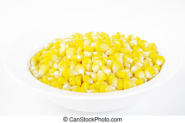 corn seeds in white bowl
