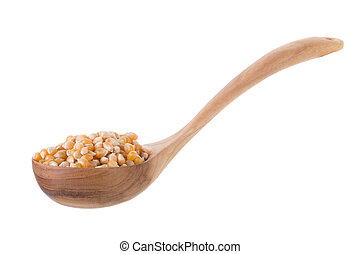 Corn seeds in wooden spoon isolated on a white background