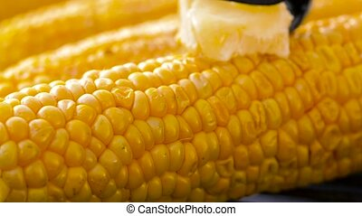 corn with melting butter roasting on grill - cooking, ...