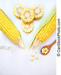 Corn with wooden spoon on white background