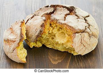 cornbread on brown wooden background