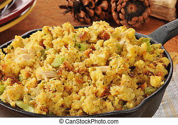 Cornbread stuffing in a cast iron skillet - Closeup of ...