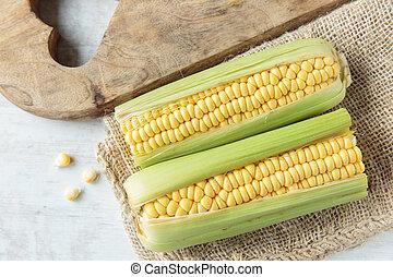Corncob - Fresh raw corncob on jute cloth
