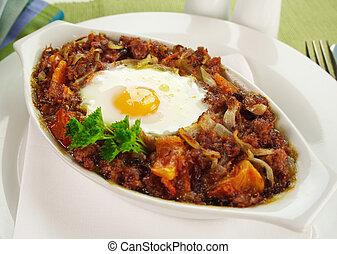 Corned Beef Hash - Baked corned beef hash with egg, tomato...