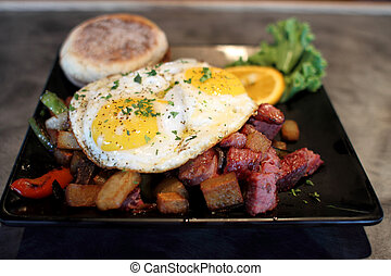 Corned beef hash with eggs sunnyside up at a restaurant.