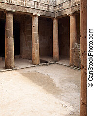 Corner and door of the ancient burial chamber with columns and doorway of tomb number 3 at the 'Tomb of the Kings' necropolis in Paphos, Cyprus.