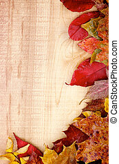 Corner Border of Wet Yellowed Autumn Leafs closeup on Rustic Wooden background