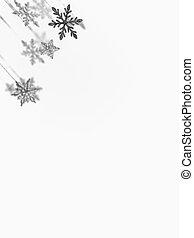 corner falling snowflakes and stars - closeup of hanging...