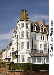 A victorian corner house with blue sky
