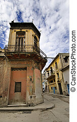 Corner in Havana street with eroded building facade against blue sky, cuba