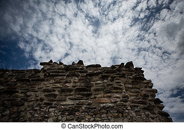 Corner of a stone wall with sky background