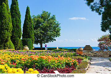 Corner of botanic garden with flowers and sea