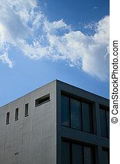 Corner of building against blue sky