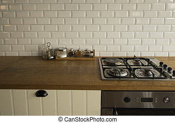 Corner of the white kitchen. The kitchen is decoration with white tile and wooden.