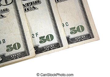 Corner of three US fifty dollar bills