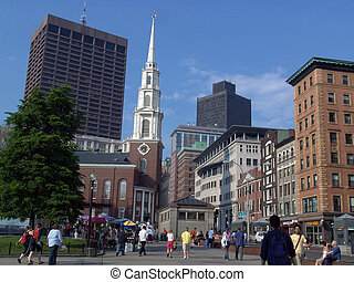 shows historic park street church with people walking through the commons in boston massachusetts, also shows park street train station