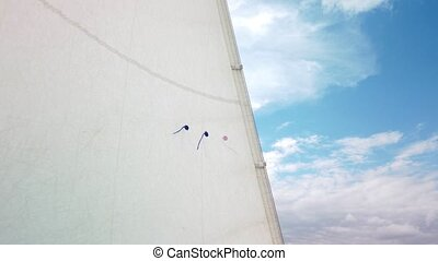Corner of White Sail On Yacht with sky on background