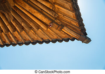 Corner of wooden roof in Korean style with IP camera