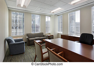 Corner office in downtown building with executive desk