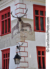 corner view of Stag House with red windows, famous landmark in Sighisoara, Transylvania Romania