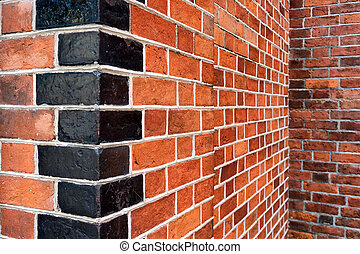 Corners of a red brick wall with cement