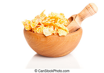 Cornflakes in a wooden bowl, isolated on white background.
